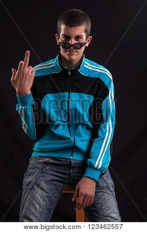 Teenage Boy With Sunglasses Pulled Off Eye Shows Middle Finger