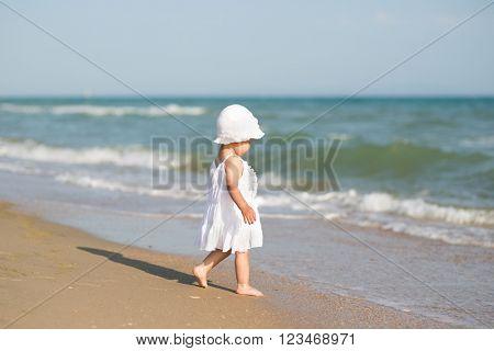 baby on the ocean beach
