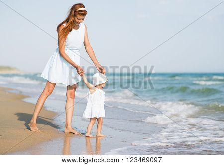 Mather and baby on the sea beach