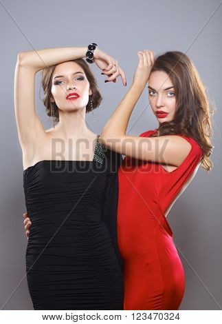 Two young beauty women standing together