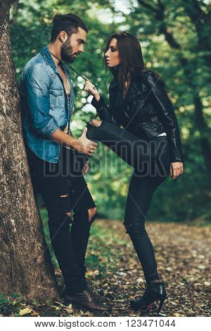 Attractive young couple flirting in the park