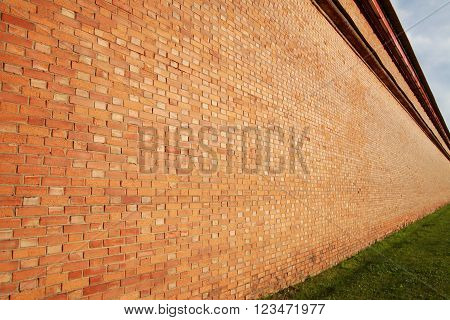 Brick wall in perspective, receding into the distance