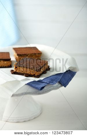 Few delicious chocolate cakes on light background