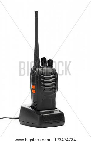 portable radio Walkie-talkie on charging station, isolated on white