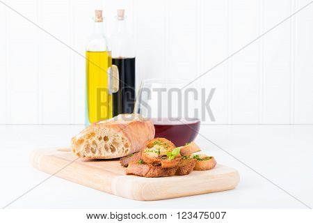 Homemade toasted baguette seasoned with olive oil and fresh herbs.