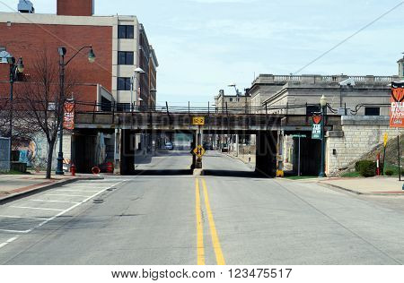 JOLIET, ILLINOIS / UNITED STATES - APRIL 12, 2015: Pedestrians and motorists may pass through the Clinton Street Viaduct in downtown Joliet.