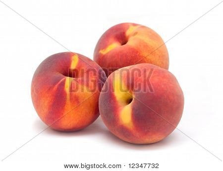 Three Orange Red Peaches  On A White Background.