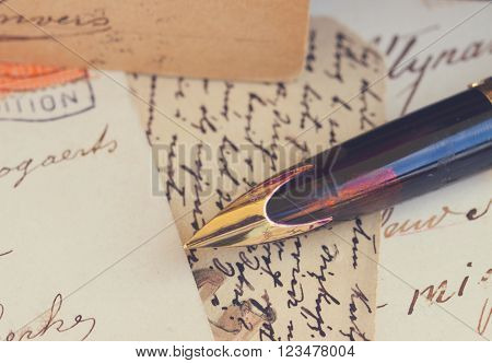old retro golden quill pen and antique letters, retro toned