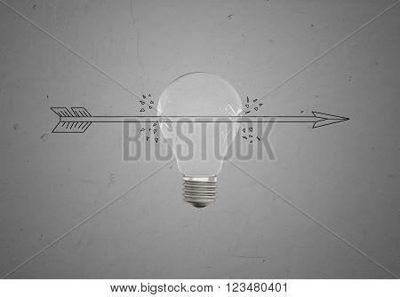 Sketch of an arrow piercing a light bulb on amid concrete wall. Concept.