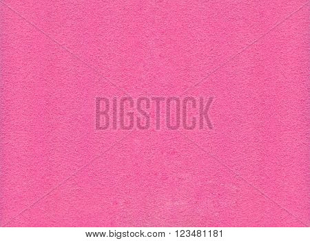 The polymeric material pink color with abstract texture in the background