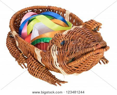 Wicker basket in the form of a frog with color bands inside isolated on white background. Three-quarter view.