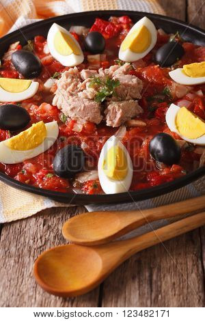 Arabic Cuisine: Tuna Salad With Vegetables And Eggs Close-up. Vertical