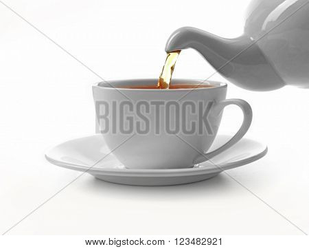 Cup of tea and teapot, isolated on white