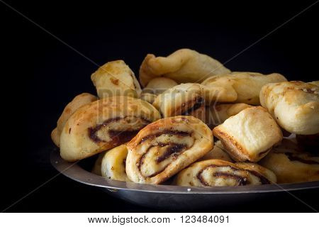 Klecha Iraqi Date Cookies on a Platter with Dark Background Horizontal