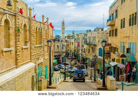 BETHLEHEM PALESTINE - FEBRUARY 18 2016: The narrow Pope Paul IV street is the central street of the city on February 18 in Bethlehem.