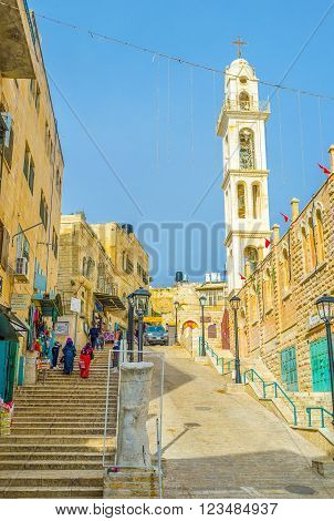 BETHLEHEM, PALESTINE - FEBRUARY 18, 2016: The view on the descent of the Pope Paul IV street and St. Mary Syrian Orthodox Church on the background on February 18 in Bethlehem.