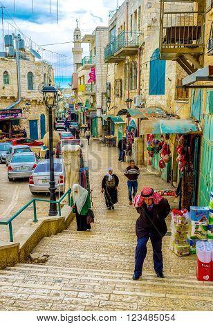 BETHLEHEM, PALESTINE - FEBRUARY 18, 2016: The keffiyeh is a traditional headdress of elderly men in Bethlehem on February 18 in Bethlehem.