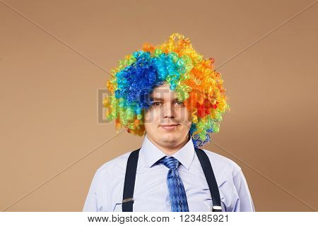 Smiling Businessman With Large Colorful Wig