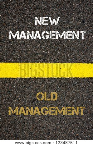 Antonym decision concept of OLD MANAGEMENT versus NEW MANAGEMENT written over tarmac, road marking yellow paint separating line between words
