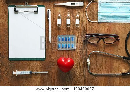 Doctor table with medical items, top view