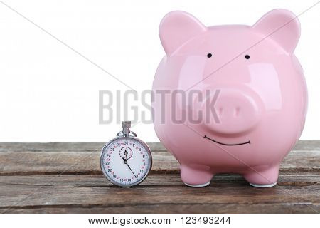 White piggy bank and a timer on white background