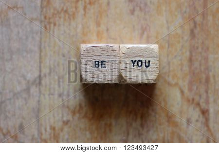Be you printed on two wood dice with wood background open for copy