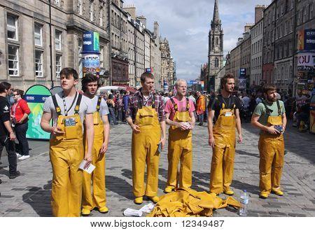 EDINBURGH- AUGUST 6: Performers in fisherman's oilskins on Royal Mile during Edinburgh Fringe Festival on August 6, 2010 in Edinburgh.