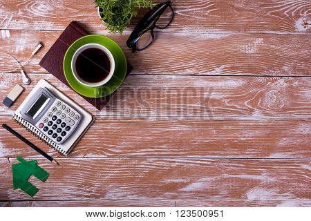 Office table with notepad, computer and coffee cup. Business creative consept.