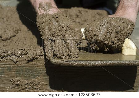 Handicrafts. Preparation Of Mud Bricks In The Plate