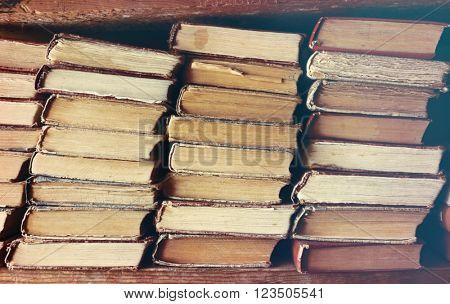 Old books standing on shelf, closeup