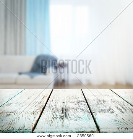 Empty wooden table and blurred room interior background