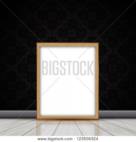 Blank picture with wooden frame leaning against a wall with Damask wallpaper pattern