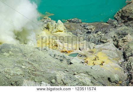 Kawah ijen Indonesia - October 16 2010 : Unidentified people mining sulfur from the sulfur mines in the crater of the active volcano of Mt.Kawah Ijen in East Java Indonesia