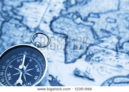 old fashioned compass and vintage map