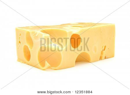 Closeup view of a piece of cheese on a white background