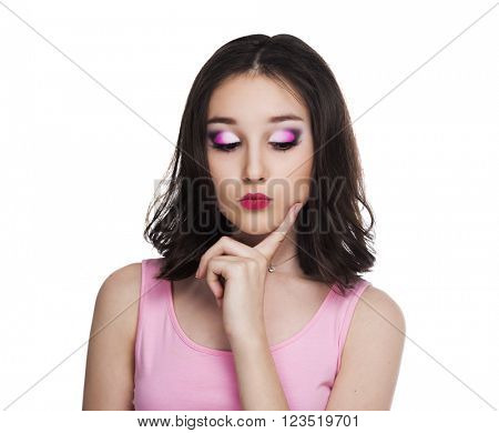 thoughtful pretty teenage girl isolated against white studio background