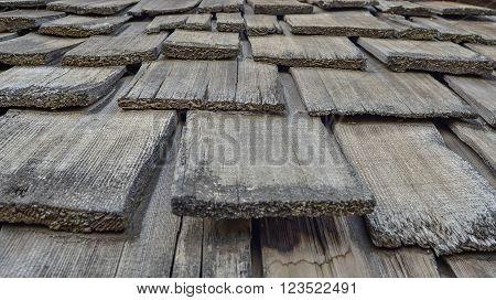 weathered, brown, wooden, shingles, rectangular pattern, close up
