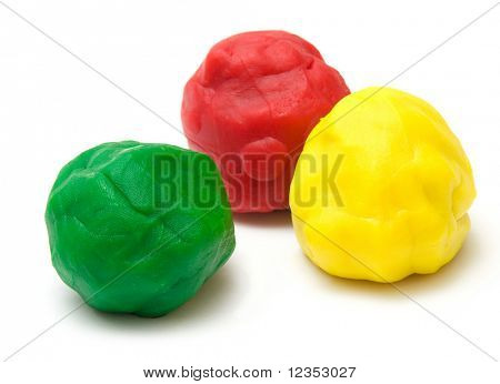 three pieces of color plasticine on white background