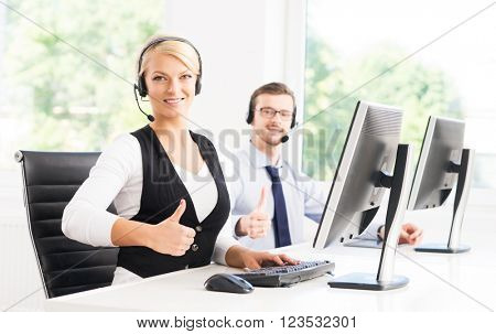 Customer support operators in formalwear working in call center office using computers. Business concept.