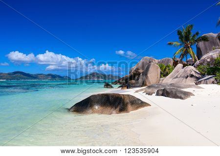 Beautiful little secluded beach at tropical La Digue island on Seychelles