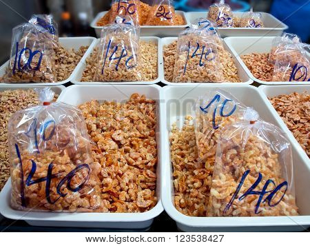 Heap dried shrimps for sell with sale price on package at market
