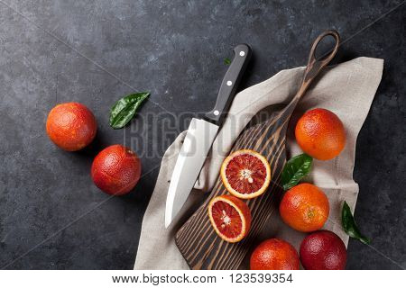 Fresh citruses on stone background. Red oranges. Top view with copy space