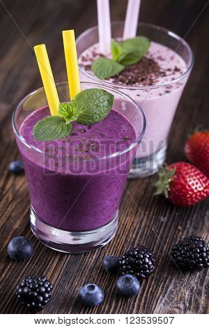 Tasty Strawberry And Blueberry Shake On Wooden Table!