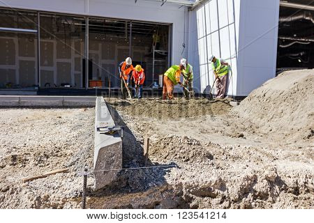 Kerb stones on gravel ground for placing road edge at construction site.