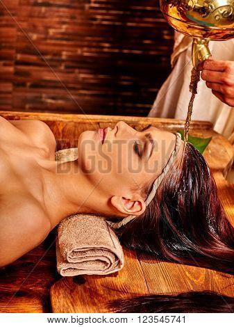 Woman having facial  and neck ayurveda spa treatment.