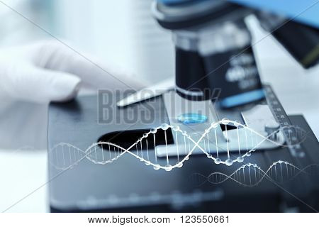 science, chemistry, biology, medicine and people concept - close up of scientist hand with test sample making research in clinical laboratory with dna molecule structure