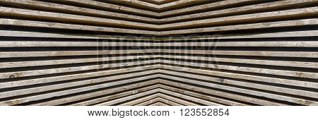 Panorama pattern of stacked, symmetrical wooden boards