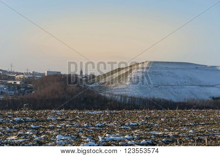 Snowy Mountain a landfill dump in the winter.