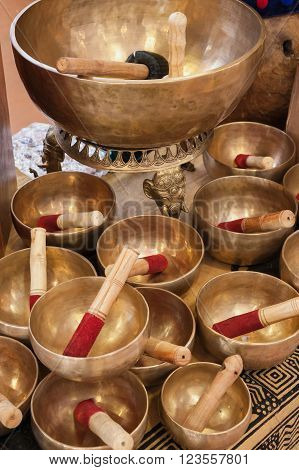 the Tibetan singing bowl spreads its low vibration