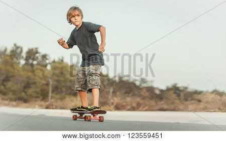 Skater  riding on the road at sunset